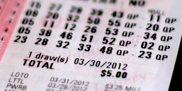 A lottery ticket purchased in Chicago, Thursday, March 29, 2012. (Associated Press)