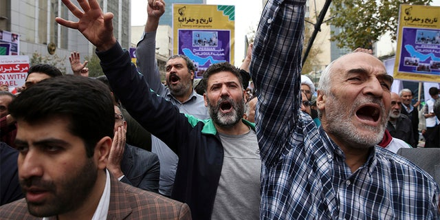 Demonstrators chant slogans during an annual rally marking the anniversary of the 1979 U.S. Embassy takeover in Tehran, Iran, Saturday.