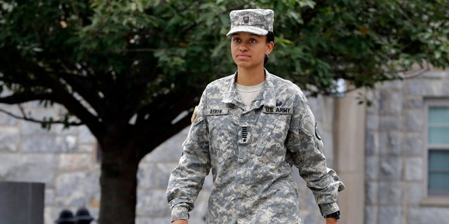 Cadet Simone Askew, of Fairfax, Va., who has been selected first captain of the U.S. Military Academy Corps of Cadets for the upcoming academic year, in West Point, NY, walks to a press conference Monday, Aug. 14, 2017.