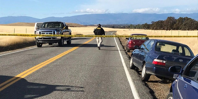 Crime tape blocks off Rancho Tehama Road leading into the Rancho Tehama subdivision south of Red Bluff, Calif., following a fatal shooting on Tuesday, Nov. 14, 2017.