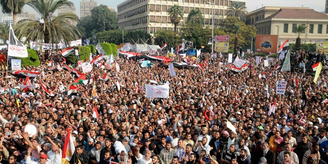 Dec. 1, 2012: Supporters of Egyptian President Mohammed Morsi rally in front of Cairo University, Cairo, Egypt.