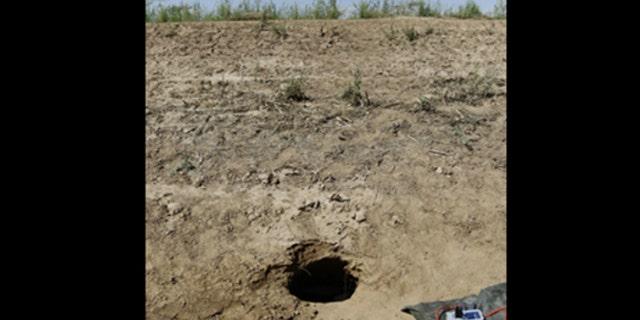 Hole marks entrance to cross-border tunnel found Thursday near Calexico, Calif. (U.S. Customs and Border Protection via AP)