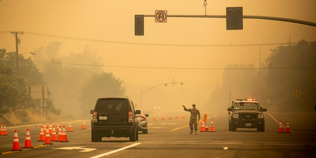 Thousands of residents were evacuated as the deadly blaze threatens homes in Redding.