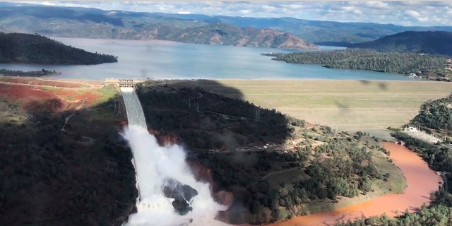 Water flows over an emergency spillway of the Oroville Dam in Oroville, Calif., on Feb. 10, 2017.