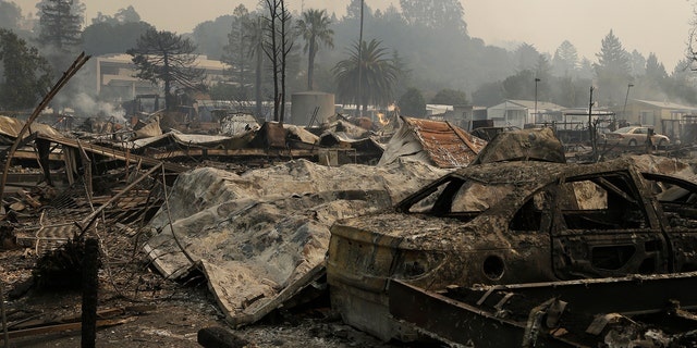 Remains from a wildfire sit at the Journey's End mobile home park on Monday, Oct. 9, 2017, in Santa Rosa, Calif.