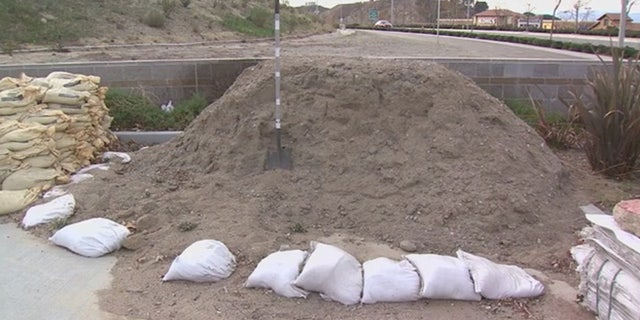 Officials handed out sandbags to residents near areas affected by the recent wildfires in Southern California.