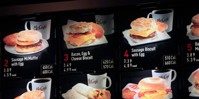FILE - In this Sept. 12, 2012 file photo, items on the breakfast menu, including the calories, are posted at a McDonald's restaurant in New York. Wondering how many calories are in that hamburger? Chain restaurants still don't have to tell you, despite a six year-old law requiring calorie labels. The Food and Drug Administration said earlier this month that it will delay menu labeling rules, again, until next year. Pushback from supermarkets and convenience stores that will be required to put calorie labels on take-out foods have slowed the process.  (AP Photo/Mark Lennihan, File)