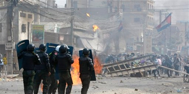 Jan. 3, 2014: Cambodian riot police prepare to confront with garment workers throwing stones and bricks near a factory on the Stung Meanchey complex on the outskirts of Phnom Penh, Cambodia.