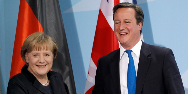 Nov. 18, 2011: German Chancellor Angela Merkel, left, and British Prime Minister David Cameron, right, shake hands after a news conference during a meeting at the chancellery in Berlin, Germany.