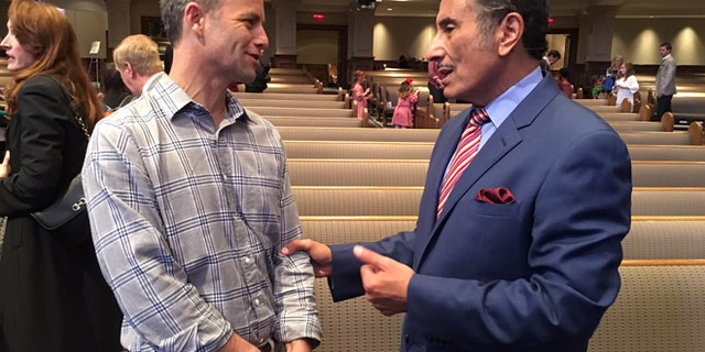 Actor Kirk Cameron, left, meets with evangelical minister Michael Youssef.