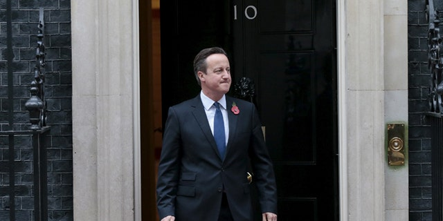 Nov. 3, 2015: Britain's Prime Minister David Cameron emerges from 10 Downing Street. (Reuters)