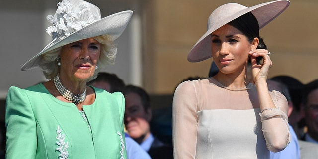 Camilla (left) with Prince Harry's wife, Duchess of Sussex Meghan Markle.