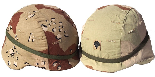 Two very different camouflage pattern helmet covers that were used by the U.S. Military in Iraq.