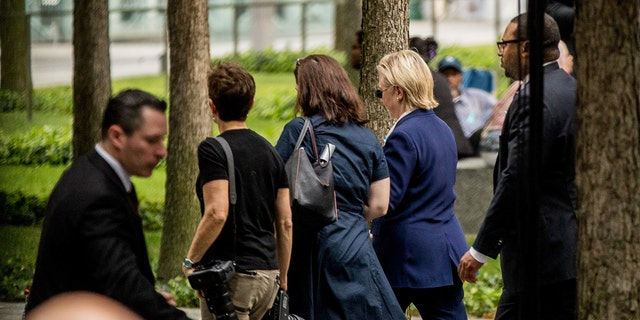 Hillary Clinton departs the 9/11 ceremony on Sunday.
