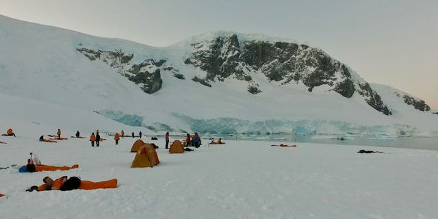 The snow-covered campsite, right next to the water, was quite a sight. There were snowy peaks as far as the eye could see.