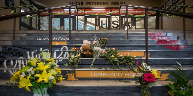 Community members leave notes and flowers at a memorial for the Humboldt Broncos team leading into the Elgar Petersen Arena in Humboldt Saskatchewan, Canada, April 7, 2018.