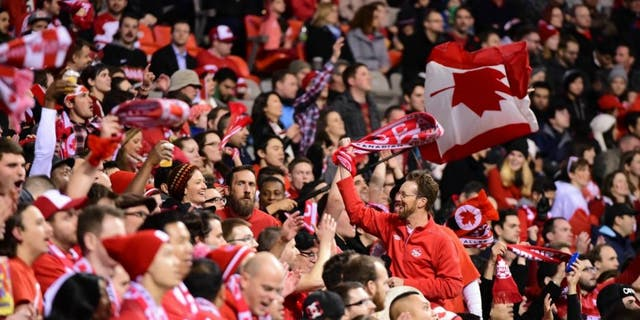 Nov 13, 2015; Vancouver, British Columbia, USA; Canadian fans celebrate during the second half in a FIFA World Cup qualifier soccer match at BC Place. Canada won 1-0. Mandatory Credit: Anne-Marie Sorvin-USA TODAY Sports