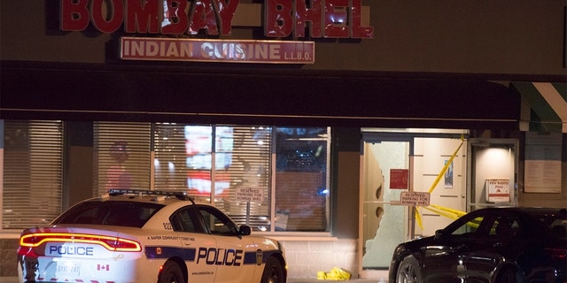Police standing outside the Bombay Bhel restaurant in Mississauga, Canada on Friday.