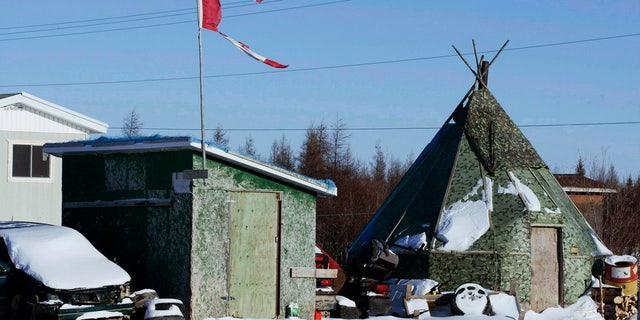 Nov. 29, 2011: A tattered Canadian flag flies over a building in Attawapiskat, Ontario, Canada