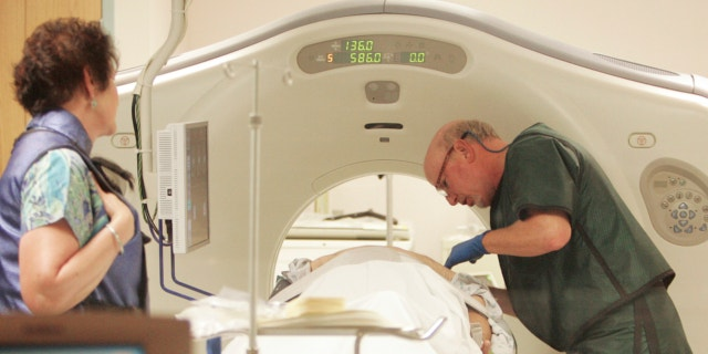 June 3, 2010: Dr. Steven Birnbaum works with a patient in a CT scanner at Southern New Hampshire Medical Center in Nashua, N.H.