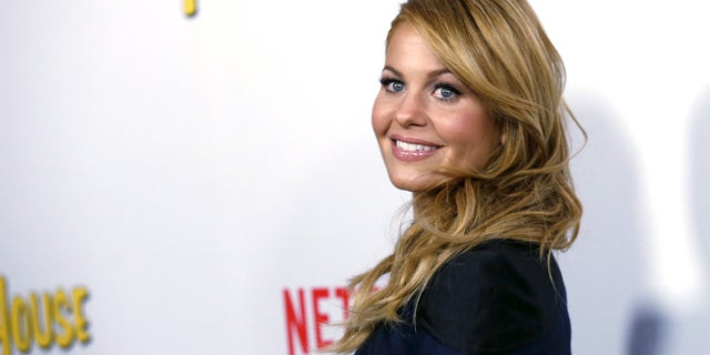 "Cast member Candace Cameron Bure poses at the premiere for the Netflix television series ""Fuller House"" at The Grove in Los Angeles."
