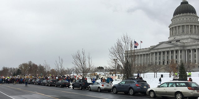 Protesters line up outside of Utah's capitol. President Trump signed a pair of executive orders to significantly shrink two of Utah's national monuments.