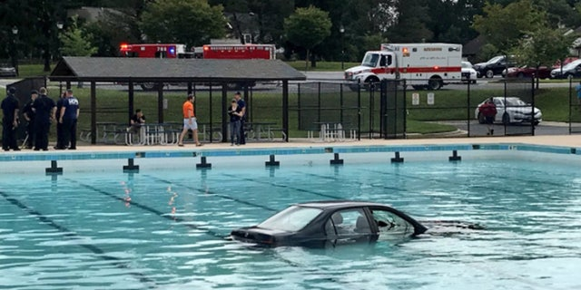 Officials say the man and the woman inside the car were able to get out safely.