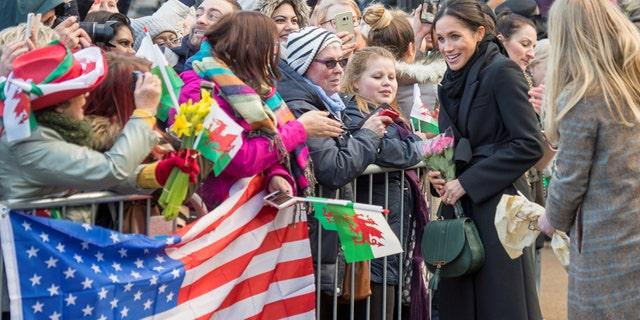 Meghan Markle greets American fans outside of Cardiff Castle.