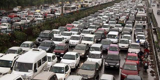 Traffic jam on the Delhi-Gurgaon road near New Delhi, India.