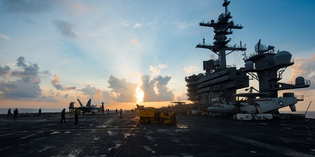 The aircraft carrier USS Carl Vinson (CVN 70) transits the South China Sea.