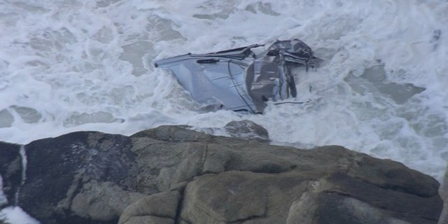 The crushed remains of a van after a man drove off a cliff in Northern California on Friday and plunged into the Pacific Ocean.