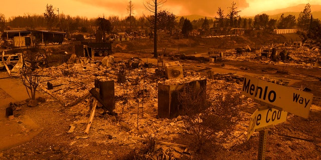 Homes leveled by the Carr Fire line the Lake Keswick Estates area of Redding, Calif.