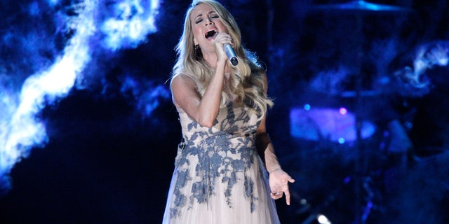 Carrie Underwood performs onstage at the 48th annual CMA Awards at the Bridgestone Arena on Wednesday, Nov. 5, 2014, in Nashville, Tenn.