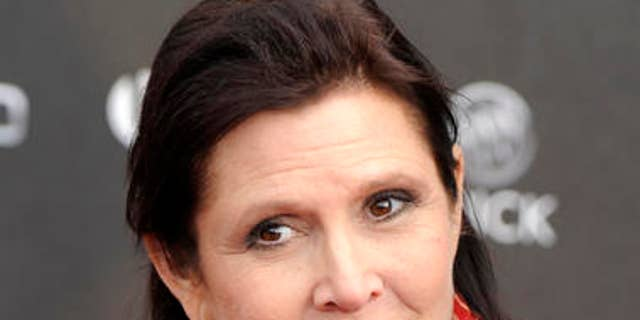 FILE - In this Thursday, April 7, 2011 file photo, Carrie Fisher arrives at the 2011 NewNowNext Awards in Los Angeles. On Tuesday, Dec. 27, 2016, a publicist said Fisher has died at the age of 60. (AP Photo/Chris Pizzello, File)