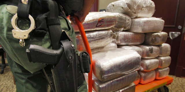Nov. 4, 2010: In this file photo, bales of marijuana are wheeled out at a news conference in Jonesboro, Ga. Forty-five people were arrested 45 people along with cash, guns and more than two tons of drugs as part of an investigation by federal and local law enforcement into the Atlanta-area U.S. distribution hub of Mexico's La Familia drug cartel.