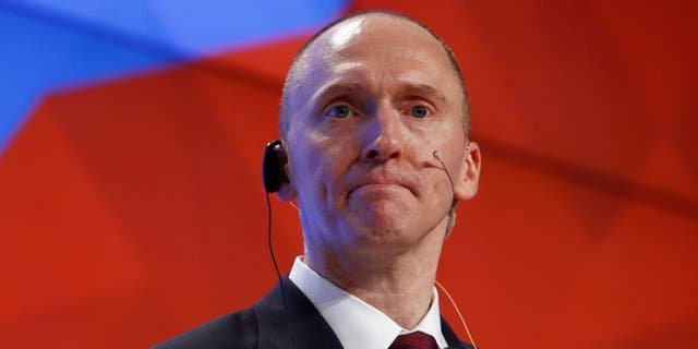 "The memo, which has been at the center of an intense power struggle between congressional Republicans and the FBI, specifically cites the DOJ and FBI's surveillance of Trump campaign adviser Carter Page, saying the dossier ""formed an essential part"" of the application to spy on him."