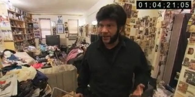 Cary, 51, in his apartment.  Courtesy TLC