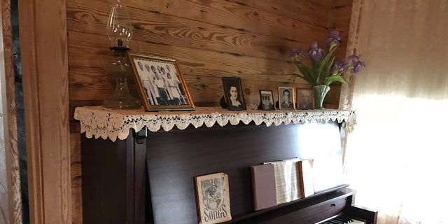The Cash family piano is one of many original items on display at the Johnny Cash Boyhood Home in Dyess, Ark. The Cash family moved to Dyess in 1935 during the Great Depression.
