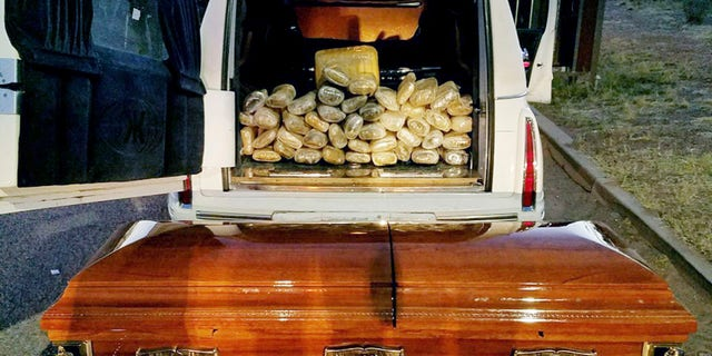 This Saturday, April 29, 2017 photo provided by U.S. Customs and Border Protection shows a hearse, the casket and the bricks of marijuana it was carrying after agents stopped the vehicle at an immigration checkpoint on State Route 80 near Tombstone, Ariz.