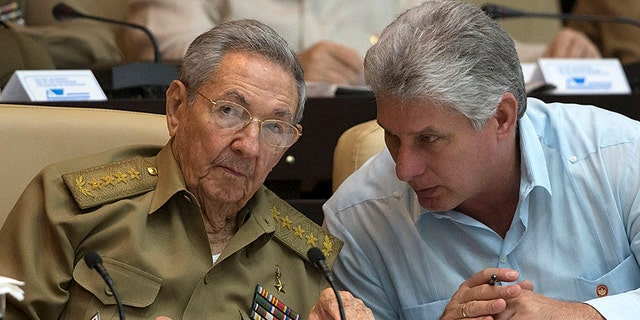 Cuba's President Raul Castro (L) chats with Cuba's Vice President Miguel Diaz-Canel react during the National Assembly in Havana, Cuba, July 8, 2016. Ismael Francisco/Courtesy of Cubadebate/Handout via Reuters.