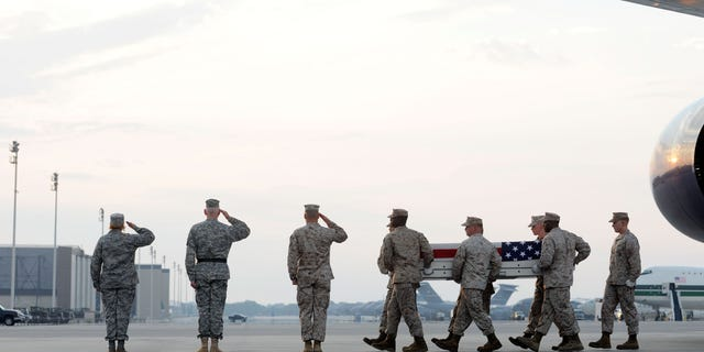 Aug. 9: A Marine carry team moves a transfer case containing the remains of Sgt. Adan Gonzales Jr. at Dover Air Force Base, Del. According to the Department of Defense, Gonzales, 28, of Bakersfield, Calif., died Aug. 7, 2011 while conducting combat operations in Helmand province, Afghanistan.