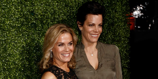 In this Jan. 6, 2011 file photo, Cat Cora, left, and Jennifer Cora arrive at the Oprah Winfrey Network Television Critics Association 2011 Winter Press Tour Cocktail Reception in Pasadena, Calif.