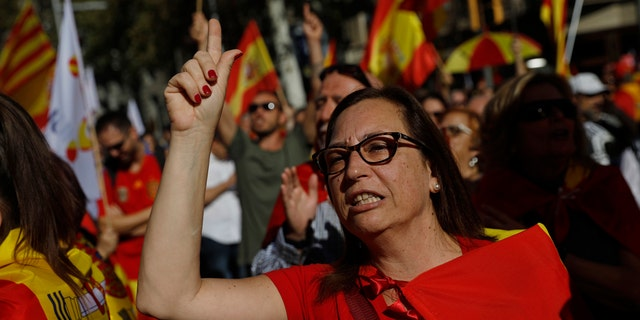 A nationalist protester gestures before a rally against Catalonia's bid for independence from Spain, Oct. 29, 2017.
