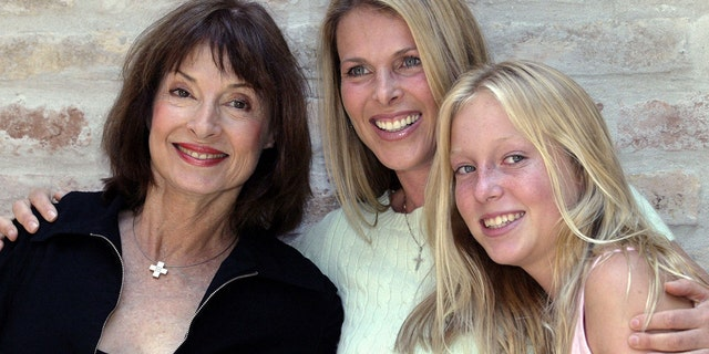 Member of Serbia's royal family Princess Jelisaveta Karadjordjevic (L) poses for a picture with her daughter U.S. actress Catherine Oxenberg (C) and grand daughter India (R) at her home in Belgrade's suburb of Zemun June 11, 2004.