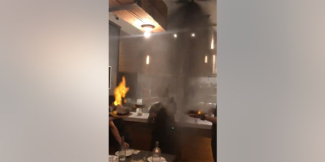 The waiters were serving up flaming plates of saganaki when the sprinkler system kicked in.