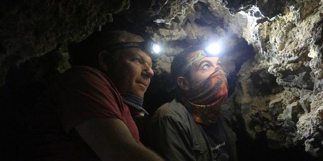 Archaeologists Oren Gutfeld & Ahiad Ovadia survey the cave.