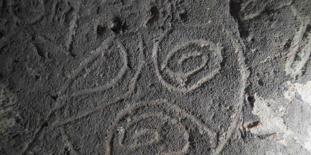 "Indigenous rock art from Mona island. ""Finger-fluted"" design scratched by the artist into the soft walls of the cave (Project El Corazon del Caribe)."