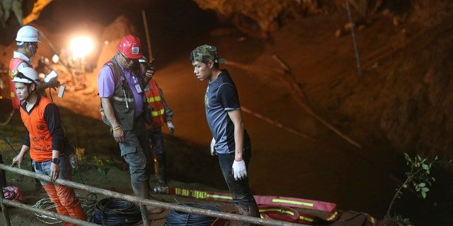 A U.S. military team and British cave experts joined the rescue effort for 12 boys and their soccer coach missing for five days inside the cave being flooded by near-constant rains.