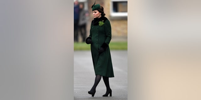 The Duchess stayed warm with tights and gloves.