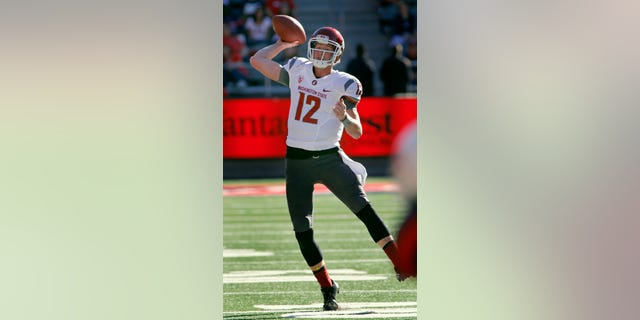 Washington State's quarterback Connor Halliday throws against Arizona in the second half of an NCAA college football game on Saturday, Nov. 16, 2013, in Tucson, Ariz. Washington State won 24 - 17. (AP Photo/John MIller)